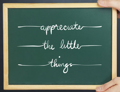 Chalkboard reading 'appreciate the little things' to help stop being sad about life and disappointment