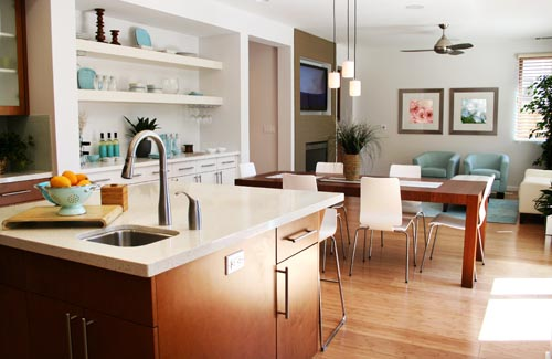Clean sunny kitchen, sitting and dining room