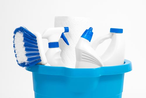 Variety of cleaning products in a bucket