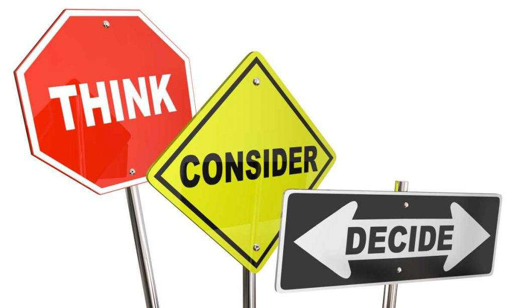 Road signs saying think - consider - decide