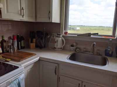 Clean kitchen counter with no dirty dishes