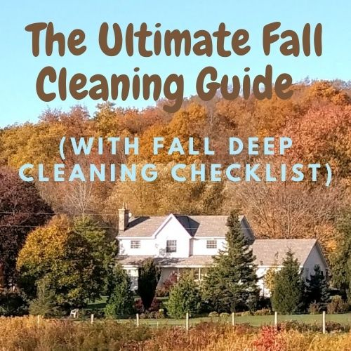 """Image title reads """"The Ultimate Fall Cleaning Guide (with Fall Deep Cleaning Checklist)"""" Background image is a house surrounded in fall colors on trees and other foliage"""